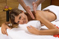 Portrait of a young woman receiving a massage from a massage therapist (thumbnail)