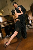 Young couple dancing at a party (thumbnail)