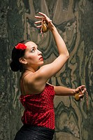 Side profile of a young woman dancing