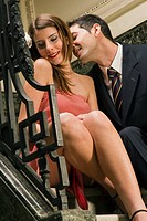 Close_up of a young couple romancing on a staircase