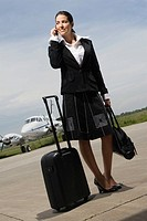 Young woman talking on a mobile phone at an airport