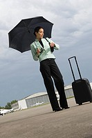 Businesswoman checking the time at an airport