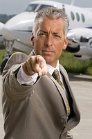 Portrait of a businessman pointing