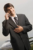 Close_up of a businessman talking on a mobile phone