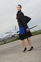 Portrait of a businesswoman walking at an airport