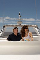 Mature adult couple relaxing on boat (thumbnail)