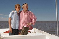 Father and son standing on boat