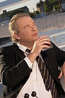 Businessman having a drink on boat