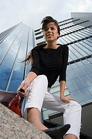 Low angle view of businesswoman in front of building