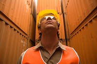 Close_up of a male dock worker wearing a hardhat