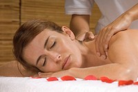 Close_up of a young woman receiving a massage from a massage therapist