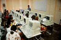 Students take instruction in a computer science class at a school in Mexico.
