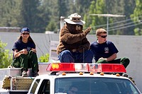 Smokey the Bear and young Forest Service workers in a small_town Fourth of July parade in Cascade, Idaho.