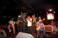 A blues band playing at a club on Beale Street in Memphis, Tennessee.