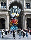 Vittorio Emmanuel II shopping arcade Milan Italy People Balloon