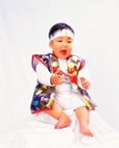 Baby boy smiling, wearing costume, front view, defocused, portrait