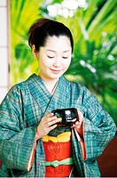 Woman putting on a kimono