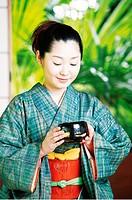 Woman putting on a kimono