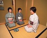Three women sitting on Tatami mat in a tea room, front view, side view, Japan