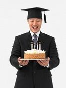 Graduate Holding Cake