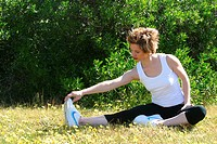 Woman Stretches on the Back Lawn