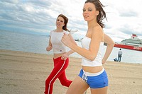 Pretty Women Jogging on the Beach