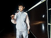 Young Asian woman playing badminton