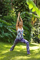 Caucasian mid_adult woman practicing yoga
