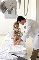 Portrait of doctor treating young patient