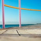 Pink and yellow painted railings of lifeguard tower on beach in Miami, Florida, USA