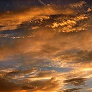 Golden clouds in sky with sunset