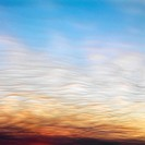 Wispy clouds in sunset colored sky (thumbnail)