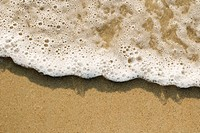 Close_up of sand and wave