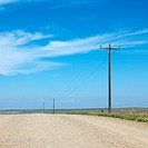 Power lines alongside dirt road in rural South Dakota