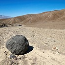 Boulder in barren landscape in Death Valley National Park