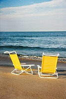 Empty lounge chairs on beach on Bald Head Island, North Carolina