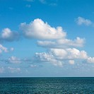 Calm water and blue sky with white puffy clouds in Florida Keys, Florida, USA