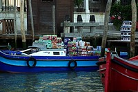 Drinks delivery barge at canal side in Venezia