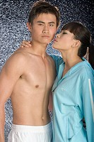Female Asian model about to kiss her man