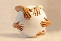 Hands Embracing Globe