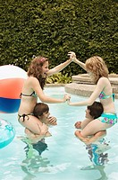 Teenagers playing in pool