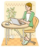 Woman using laptop and sitting at table, front view