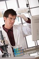 Scientist experimenting in lab