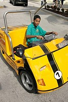 Florida, Miami Beach, Lincoln Road Mall, Black teen male, rental 3-wheel gas powered vehicle,