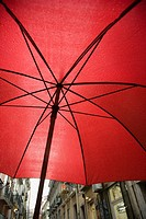 View from beneath red umbrella in Lisbon, Portugal