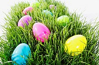 Colored eggs in a patch of grass