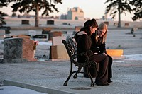 Two women praying together