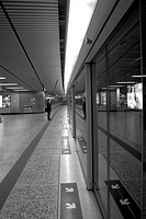 Solitary Man Standing in Train Station _ Hong Kong
