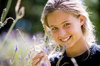 Girl 8-10 in field, smiling, portrait, close-up