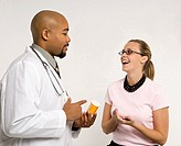 Mid_adult African_American doctor and Caucasian mid_adult female patient discussing medication.